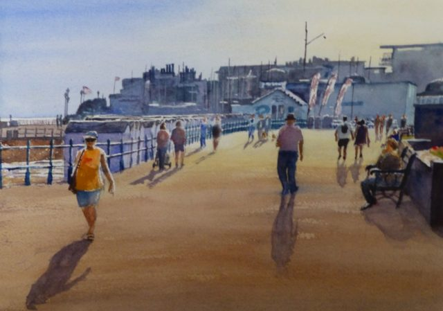 Strollers on Bexhill promenade in the afternoon towards the sailing club. Waatercolour painting