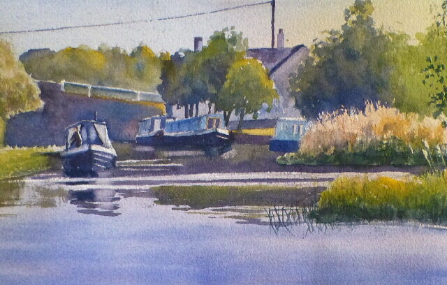 A watercolour painting of the Leeds Liverpool Canal at Halsall by the Saracens Head pub with moored narrowboats and the bridge.