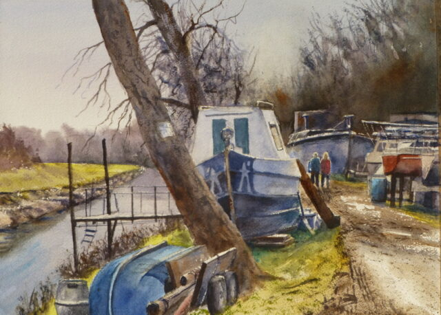 A Watercolour painting of a boatyard with boats out of the water and undergoing maintenance with the river and jetty in the background